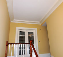 Stairway balusters and risers, and upstairs hallway walls, moldings and ceiling.