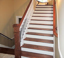 Freshly painted stair risers, balusters, walls and moldings.